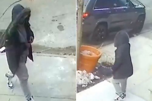 Gunman caught on video shooting into jeep - and missing target