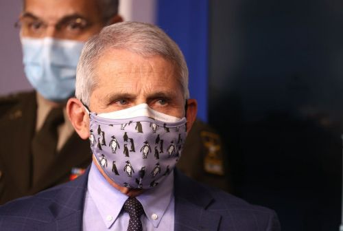 Masks will be needed until at least 2022 'for the safety of the nation,' says CVS chief