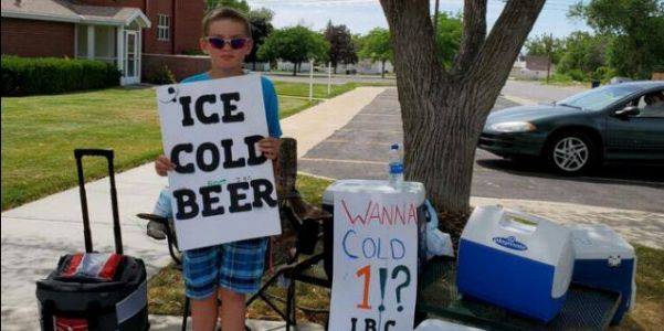 Police were called to the scene of a boy selling 'Ice Cold Beer,' but found it was just a 'marketing strategy'