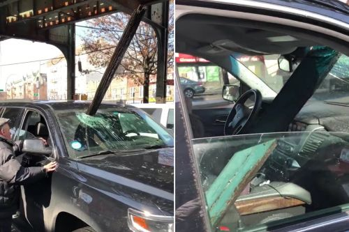 Wood from subway tracks crashes through car windshield
