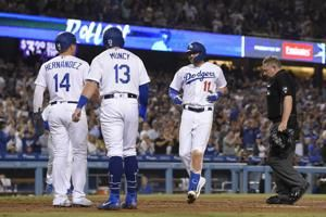 Pollock homers in Dodgers' 12-5 rout of Rockies for 99th win