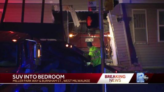 SUV crashes through apartment, narrowly misses sleeping woman