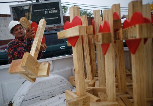 Man who's made crosses after tragedies makes 'toughest' ones in Aurora, his hometown