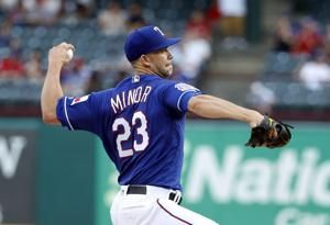 Minor 11 Ks, Rangers 5 homers in 10-9 win over Mariners