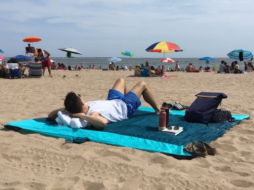 This $30 beach blanket lays flat and doesn't fly away - here's why I'll never go to the beach or park without it