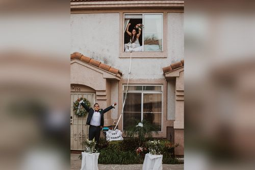 COVID-19 positive bride says 'I do' from parents' second-story window