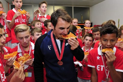 Roger Federer hosted a pizza party for the ball boys and ball girls after his latest win