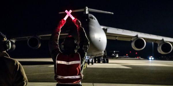 How a crew flying the Air Force's biggest plane landed safely after amid aircraft warnings and a medical emergency