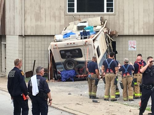 RV loses control and smashes in another vehicle and building