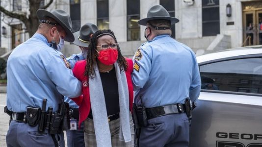 Georgia state Democratic lawmaker arrested while trying to watch Gov. Kemp sign voting bill