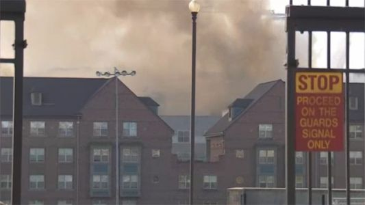 Crews rescuing residents from fire near DC Navy Yard