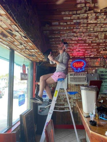 Bar owner removed $3,714 worth of bills stapled to the walls to give to her unemployed staff