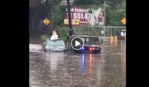New Jersey police rescue wedding party from flooded road