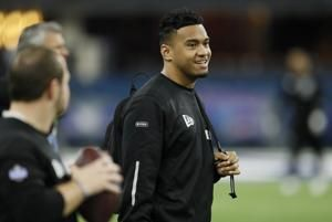 Dolphins' Tagovailoa is a playful, willing backup - for now