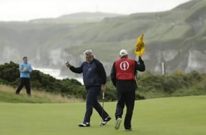 The Latest: Woods struggles to 7-over 78