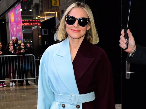 Kristen Bell made a winter fashion statement by wearing 3 colorful coats in one day