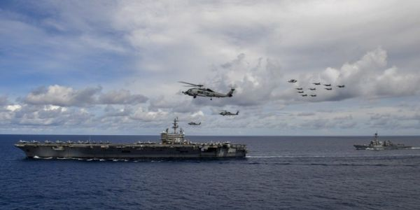 The US is officially rejecting Beijing's disputed claims to most of the South China Sea and its 'predatory' moves to impose them