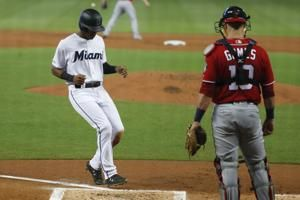 Nationals lose at Marlins 5-3 to tighten NL wild-card race