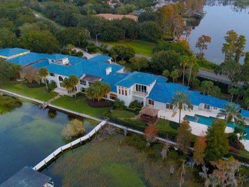 Shaq is selling his lakeside Florida mansion for $22 million, and it comes with a 17-car garage and a 6,000-square-foot basketball court - here's a look inside