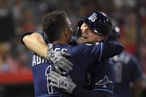 Homer barrage keeps Rays in wild card spot, tops Angels 11-4