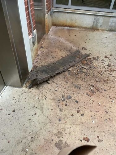 Metal falling from stairs narrowly misses Red Line rider