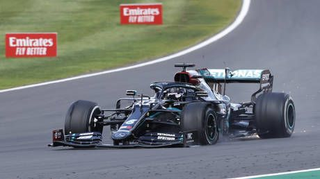 'Bonkers!': Lewis Hamilton wins record seventh British Grand Prix despite finishing race with ONLY THREE TYRES