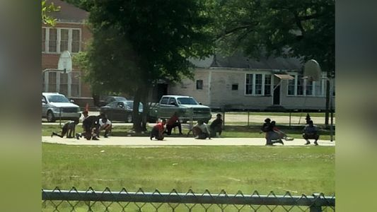 Viral picture: Teens playing basketball stop game, kneel for funeral procession