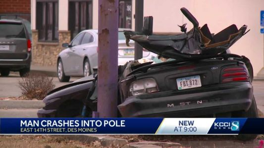 Watch: Man alert, talking after vehicle crashes into pole on East Euclid