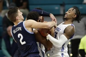Ewing wins again at MSG, Hoyas beat No. 22 Texas
