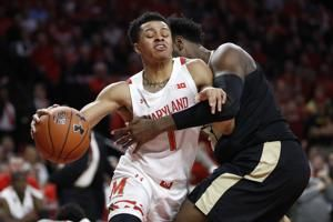 Smith scores 18 and No. 17 Maryland holds off Purdue 57-50
