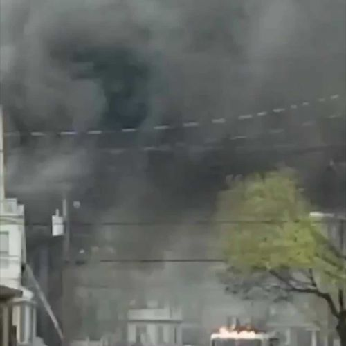 Firefighters battling multi-alarm fire in three-family home