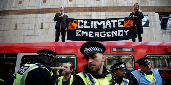 Climate change protestors cause a week of chaos in London, blocking major roads, crippling public transport, and gluing themselves to trains