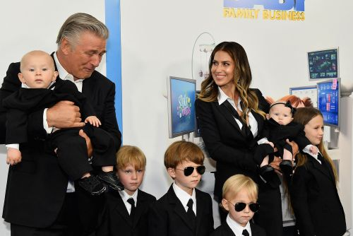 Alec and Hilaria Baldwin match their six kids in suits at movie premiere