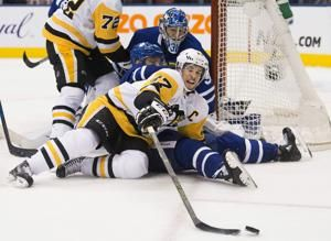 Muzzin helps Maple Leafs blank Penguins 4-0