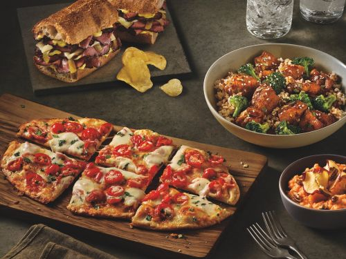 Panera wants customers to visit for breakfast, lunch, and dinner - and it's testing new flatbreads and a pastrami sandwich to convince them