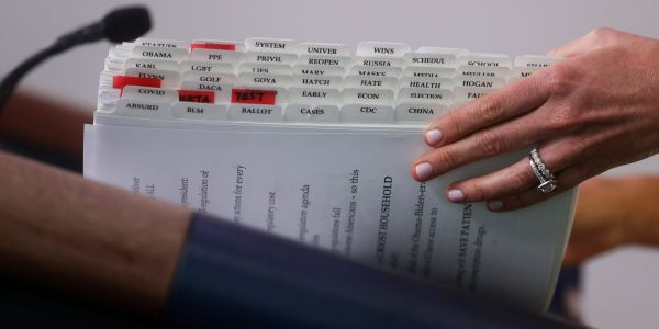 A White House photographer snapped a photo of the press secretary's helpful notes - here's what we think they mean