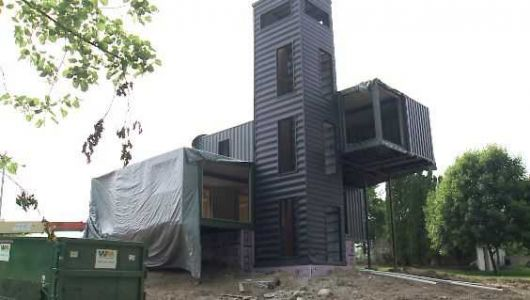 Couple building home made of shipping containers