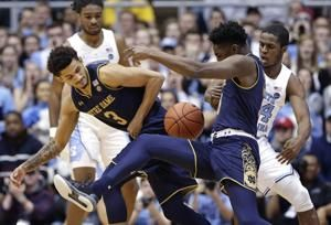 Little, No. 13 North Carolina hold off Notre Dame 75-69