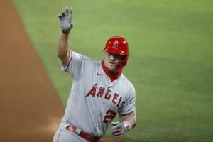 Trout homers again on birthday, but Angels fall to Rangers