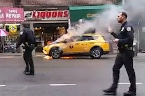 Taxi bursts into flames on the Upper East Side