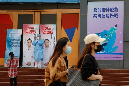 China ramps up vaccination drive with free eggs, other goods