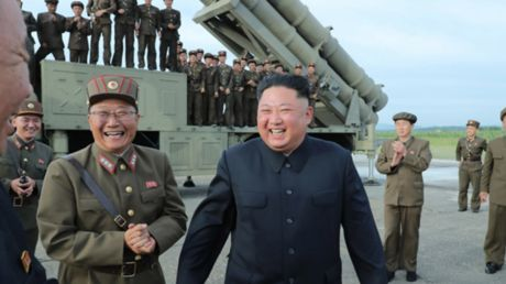 He does love missiles! Smiling Kim tests N. Korea's 'super-large multiple rocket launcher'