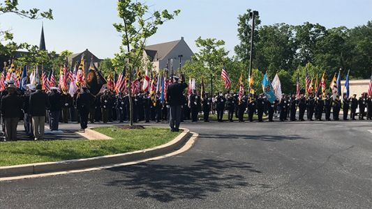 Officers, community pay tribute to Officer Amy Caprio at funeral