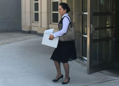 A former Air China flight attendant pleads guilty to illegally smuggling packages for Chinese officials, US prosecutors say