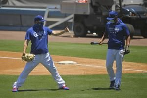 Who are those masked men? Dodgers resume camp with new rules
