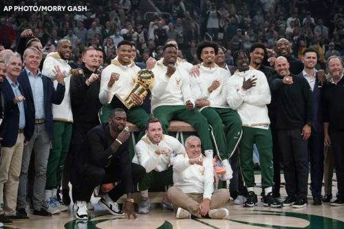Bucks begin defense of title with win over Nets