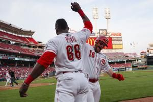 Puig's long homer helps Reds beat Braves 7-6
