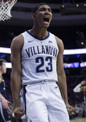 College basketball roundup: Booth helps No. 9 Villanova beat Quinnipiac 86-53