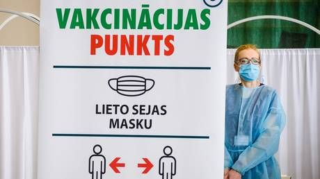 Latvia orders lockdown as PM decries low Covid-19 vaccine uptake and far-right MP blames Russian 'colonists' reluctant to get jab