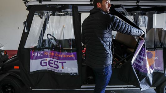 Free golf cart ride service expands into Newport